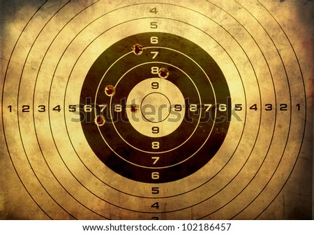target with bullet holes over...