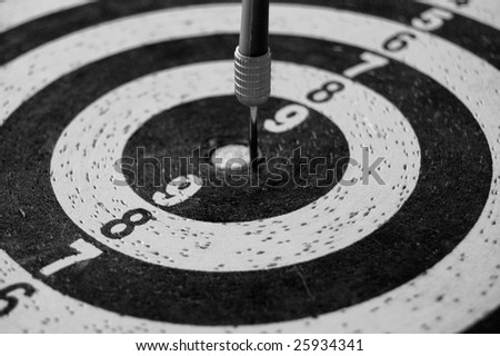 Target with dart arrow abstract sports background. Black and white.