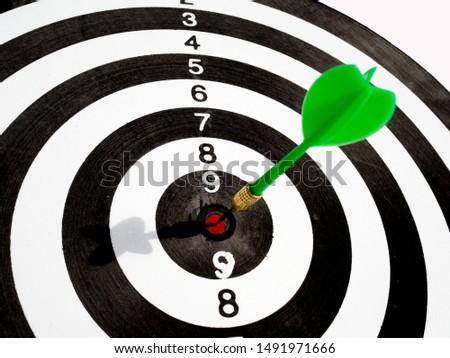 Target with green dart focus on bull's eye, Setting challenging business goals And ready to achieve the goal concept.