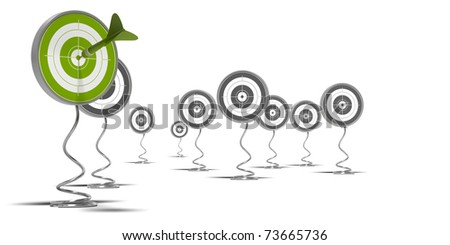 targets mounted on pedestal, there is a green target on the foreground and grey ones at the background - stock photo