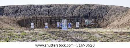 Targets set up in front of a mound of dirt for target practice