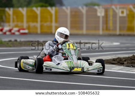 TARGU SECUIESC, ROMANIA - MAY 20: Andrei TOmescu, number 11, competes in National Karting Championship, Round 2, on May 20, 2012 in Targu Secuiesc, Romania.