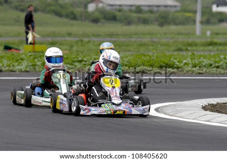 TARGU SECUIESC, ROMANIA - MAY 20: Supuran Victor, number 2, competes in National Karting Championship, Round 2, on May 20, 2012 in Targu Secuiesc, Romania.