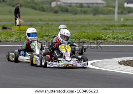 TARGU SECUIESC, ROMANIA - MAY 20: Supuran Victor, number 2, competes in National Karting Championship, Round 2, on May 20, 2012 in Targu Secuiesc, Romania.