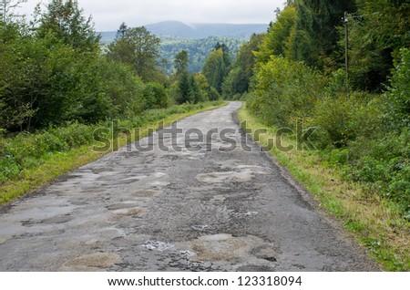 Tarmac road with big holes