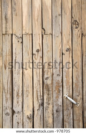 Tarnished Wooden Door exposed to air and moisture