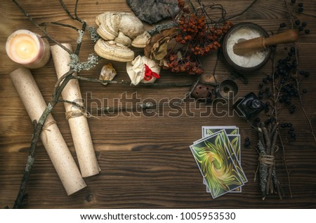 Tarot cards on fortune teller desk table. Witch doctor. Witchcraft. Magic herbal collection. #1005953530