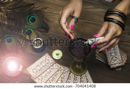 Tarot cards on fortune teller table. Divination. Witchcraft. Witch prepares a magic potion. #704041408