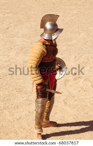 TARRAGONA, SPAIN - MAY 29: A gladiator on the arena of Tarragona\'s Amphitheater on May 29, 2010 in Tarragona, Spain. The show recreate a gladiators fight.