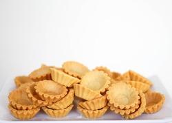 tart shells on white plate background