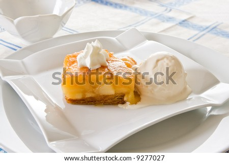 Tarte Tatin, delicious French dessert with puff pastry, apple and ice-cream