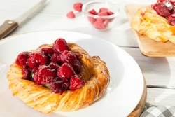 tartlet with berries, sweet pastries on a white table, pastry shop.
