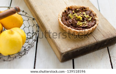 tartlet with chocolate cream and lemon in a basket