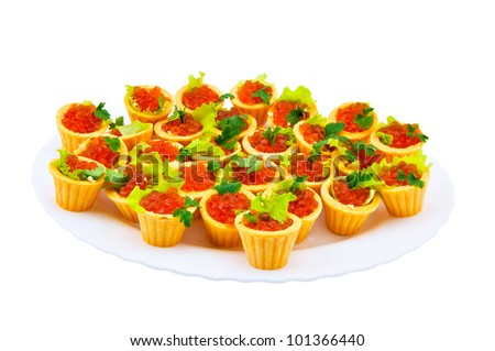 Tartlet with red caviar on a dish