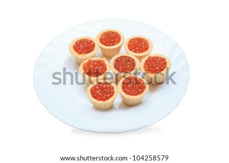 tartlet with red Caviar on white plate