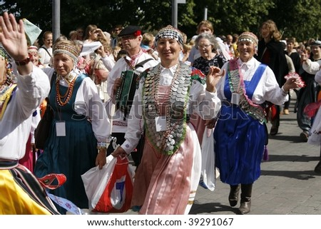 TARTU, ESTONIA - JULY 16: Participants of Tartu Hanseatic Days marching through the city. Tartu is a historical hanseatic city and celebrates it annually on July 16, 2006 in Tartu, Estonia.