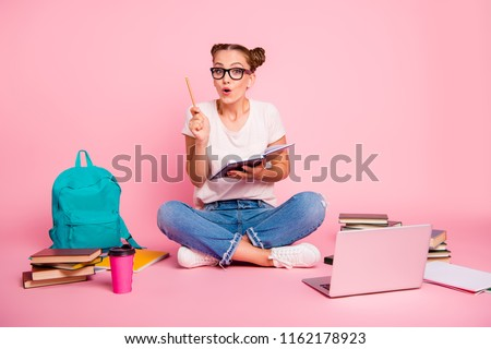 Task, test, learning concept. Full legs, body, size portrait of imagine, inspiration, intelligent, reader girl sitting on the floor in classroom visited the idea isolated on bright pink background