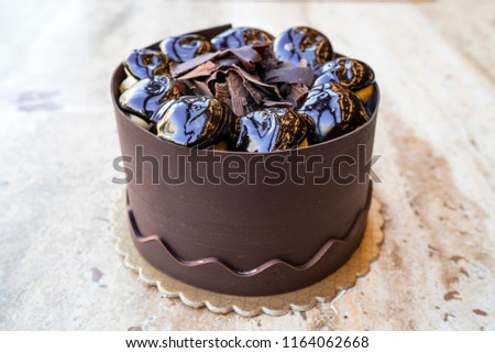 Stock Photo taste cocoa cake, profiterole on the cake