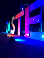 TASTE in large letters and multicolour lighting
