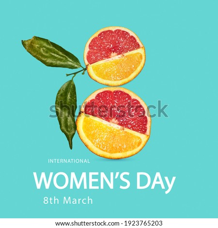 Taste mix. Top view of lemon and orange fruit in shape of number 8 over blue background. Greeting card, postcard for Women's Day March 8th. Concept of holidays, greetings. Copy space for design, ad.