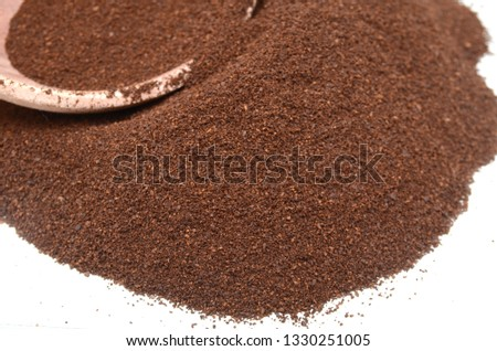 Taste of ground medium coffee closeup #1330251005