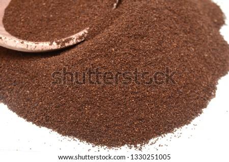 Taste of ground medium coffee closeup #1330251005
