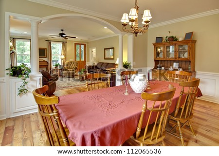 tasteful dining and livingroom with wood furniture