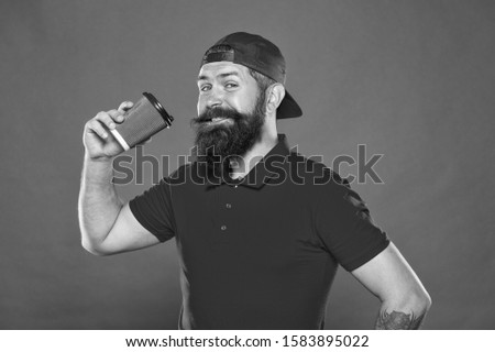 tastes perfect. brutal stylish barista. energy concept. hipster barista red background. barista job. coffee shop advertisement. take away drink. be active whole day. bearded man drink morning coffee.