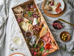 Tasting Board with cheese, antipasto, fresh fruit and condiments
