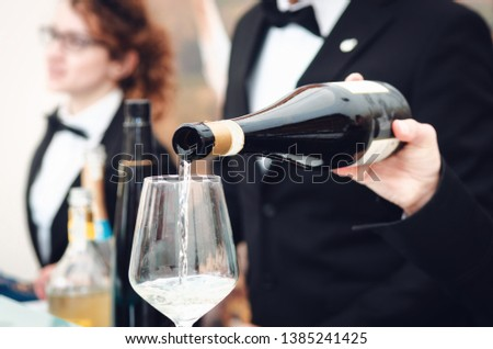 Tasting experience with a sommelier serving a glass of Moscato d'Asti (Muscat) sparkling wine in Alba (Piedmont, Italy) Zdjęcia stock ©