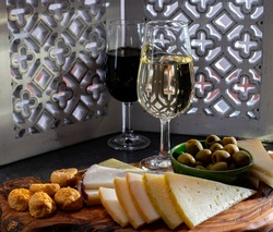 Tasting of fortified Andalusian fino sherry wine with traditional Spanisch tapas, green olives, goat and sheep manchego cheese