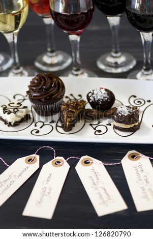 Tasting of wine and pattie chocolate pastries.