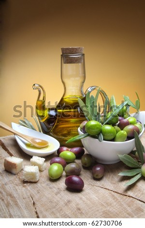 Tasting olive oil and freshly harvested olives