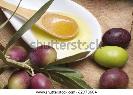 Tasting olive oil and freshly harvested olives. - stock photo