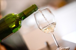 Tasting-White wine pour in a glass