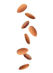 Tasty almonds falling on white background