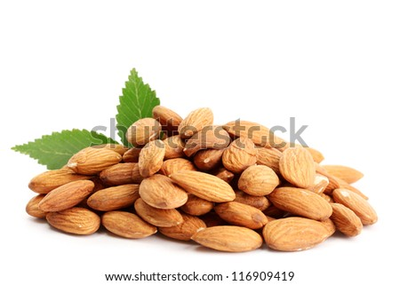 tasty almonds nuts with leaves, isolated on white