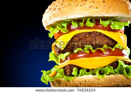 Tasty and appetizing hamburger on a dark blue background