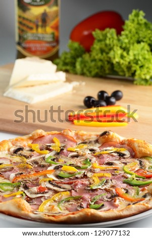 tasty and hot pizza with pepper and olives