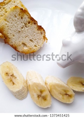 tasty and tasty lunch of bananas and kefir bread in a white plate on a white background #1373451425