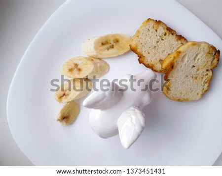 tasty and tasty lunch of bananas and kefir bread in a white plate on a white background #1373451431