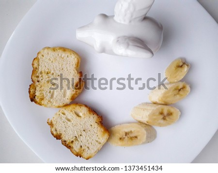tasty and tasty lunch of bananas and kefir bread in a white plate on a white background #1373451434