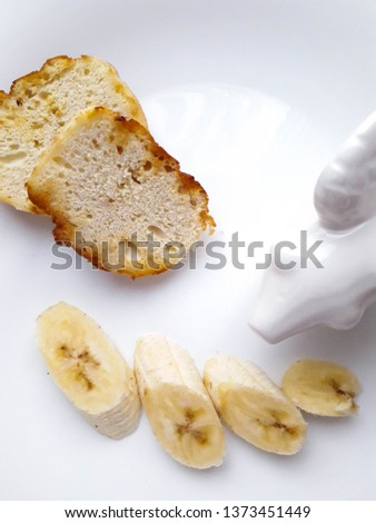 tasty and tasty lunch of bananas and kefir bread in a white plate on a white background #1373451449