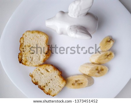 tasty and tasty lunch of bananas and kefir bread in a white plate on a white background #1373451452