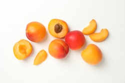 Tasty apricots on white background, top view