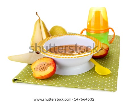 Tasty baby fruit puree and baby bottle isolated on white