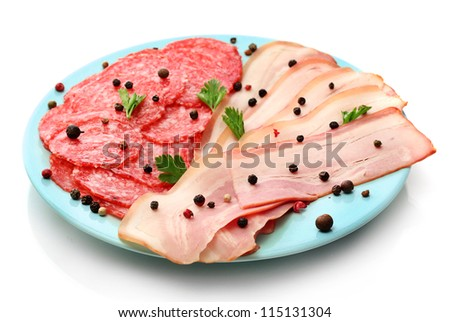 tasty bacon and sausage with spices on plate, isolated on white