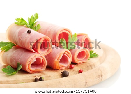 tasty bacon with spices on wooden cutting board, isolated on white