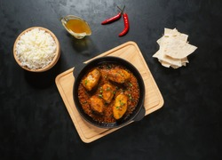 Tasty Bengali food dishes with basmati rice and Kerala fish curry.