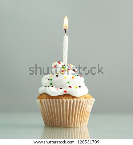 tasty birthday cupcake with...